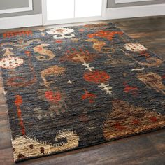 Jute Ikat in Navy, Gray, Orange and Taupe Rich in color, texture and style, this striking Ikat pattern rendered in brushed jute has subtle color variations for a luxurious shimmering effect in weathered tones of deep blue gray, burnt orange, red, taupe and brown. 100% jute. Hand knotted