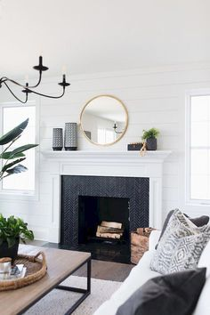 Most up-to-date Pictures black Fireplace Mantels Ideas 40 Best Modern Farmhouse Fireplace Mantel Decor Ideas Farmhouse Fireplace Mantels, Fireplace Remodel, Modern Fireplace Decor, Tiled Fireplace, White Mantle Fireplace, Marble Fireplaces, Fire Place Mantel Decor, Renovate Fireplace, Fireplace In Living Room