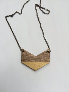 This cool and modern chevron necklace is a great gift for a friend...or for yourself! ♥ The wood chevron pendant is laser cut and hand-stained