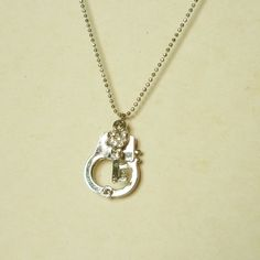 Small key and handcuff silver plated necklace