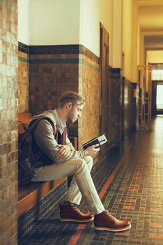 guy reading in the hallway