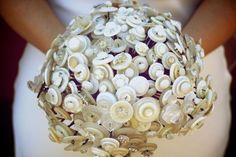 Button Bouquet - unique wedding ideas  I think your mom collects buttons...might be neat to use them:))