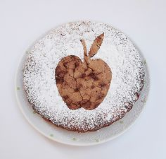 Apple cake powdered sugar decoration--Cut out a simple paper shape, or even a few shapes, or use a ready made paper doily, place it on your cake and sprinkle the powdered sugar over your cake using something like a little strainer to make sure the sugar goes on in a fine layer, not in clumps. Carefully remove the paper by slipping a knife under it, and voila!