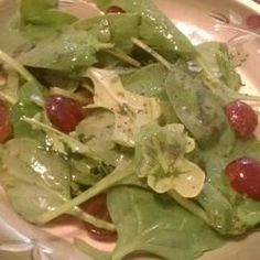 Arugula and Romaine Salad with Red Grapes Allrecipes.com