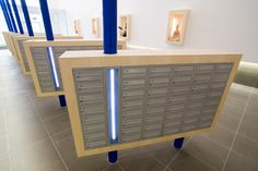 The Reflections Project featuring banks of mailboxes and integrated light.