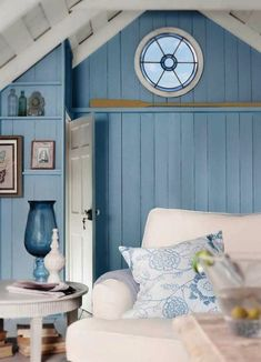 Beach house with a beautiful view through a round window from the bedroom. Check out the image by visiting the link. #homedecortips