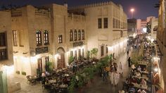 Tourists and locals dine in the Souq Waqif in Doha, Qatar. The Souq Waqif is among the capital's biggest tourist attractions.