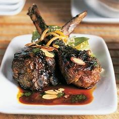 These grilled lamb chops get their Moroccan flavor from a mint chutney marinade and from the sweet and spicy barbecue sauce that's drizzled over the lamb.