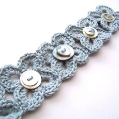 simple bracelet design ~ crocheted flowers, surface embellished with a button