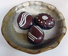 Chocolate candies, painted rocks