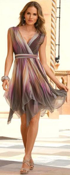 Love this flowy, fun, colorful dress. With a strappie tank underneath, obviously,  or the v -neck pinned higher. I like to be more modest!