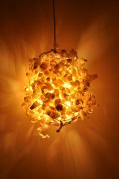 Homemade lamp, wood shavings on grid.