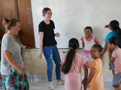 Our volunteers Marjut and Paula who are having a lot of fun with their students during the English class.