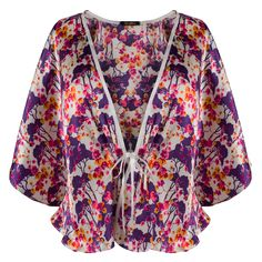 Ayten Gasson Holly Floral Silk Bed Jacket: A stunning Liberty of London silk bed jacket with an bright purple, yellow and pink 1920's inspired floral print. Designed and handmade in our Brighton Boutique.  -100% Liberty of London silk  -The mid length silk jacket features delicate pleating along the front and a simple ribbon tie -The Holly bed jacket can be teamed with Holly Silk Knicker and Holly Silk Bra  -For an alternative look, the bed jacket can sit beautifully with jeans or a pencil…