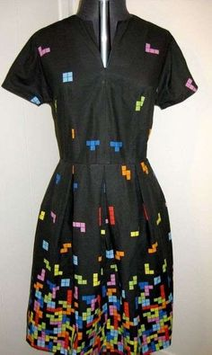 Quote:  If you are looking for the perfect Christmas gift to bestow upon your avid gamer girlfriend, then you have no further to look than at the Tetris Dress, which features the infamous blocks falling down to the hem of the dress.    The Tetris dress literally looks like an old school version of the beloved game and, in a cutesy design detail, the front lapels are a soft powder blue to match the falling blocks.