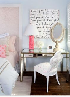 Cute bedroom -- cute little desk as a nightstand on one side with a chair