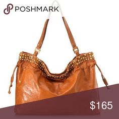 """Tory Burch Linden Tote Condition - Pre Owned  Extra Large Width 20.0"""" Height 14.0"""" Depth 6.0"""" Handle Drop 12.0""""  Product Details Type of Material: Leather Color: Brown Pockets: Interior Zip, Cell phone Hardware: Brass Closure: Magnetic  Polished punk from Tory Burch. A slouchy leather tote with three rows of metal stud detail, plus double shoulder straps, magnetic top closure, brass hardware, and lined interior with zip and cell pockets. Dimensions: 20""""L x 6""""W x 14""""H. 12"""" handle drop. Tory…"""
