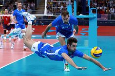 Italy's Cristian Savani (c.) dives to save a point past his teammate Dragan Travica during their men's quarterfinal volleyball match against the US at Earls Court in London, Aug. 8. - The Christian Science Monitor - CSMonitor.com