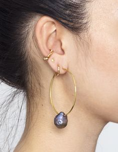 The black Sand Pearl Hoops in Yellow Gold paired with the treasure cuff in Yellow Gold with White Topaz Fashion Earrings, Fashion Jewelry, Cleaning Silver Jewelry, Metal Fashion, Black Sand, Treasure Island, Natural Shapes, White Topaz, Precious Metals
