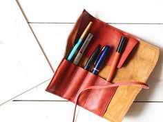 Select your favorite pencil,fountain pen,cutter,etc...  Roll those with natural tanned leather.  Inside this pen case, good pig skin leather by HibarryHillsTokyo $80 on etsy