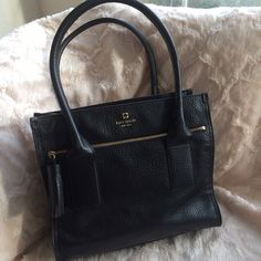 Kate Spade Southport Avenue Oden -NWOT Beautiful black kate spade bag in perfect condition. Pebbled leather finish and striped inside. kate spade Bags Totes