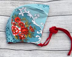 Ruby Red and turquoise reversible baby bonnet