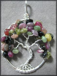 Tree of Life Pendant in Multi Watermelon Tourmaline Gemstone and Sterling Silver Wire Wrapped $60      #treeoflife #tree #treejewelry #jewerly #jewellry #treependant #gemtree #beadedtree #wirewrapped #silver #sterlingsilver #sterling #handmade #PFD #PhoenixFireDesigns #watermelon #tourmaline #pink #green #black #brown