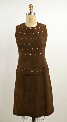 1) Suede Dress - 1966...Imagine this top in leather or suede. Change the skirt to a full skirt in chiffon with embellishments. Or have the embellishments along the border & edges.