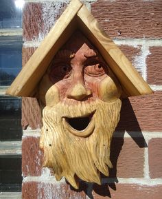 Hand carved cedar birdhouse, perfect for indoor or outdoor use.