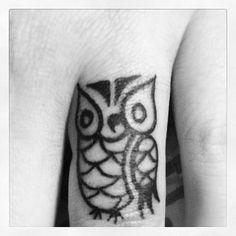 owl finger tattoo.