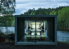 Riverside concrete pavilion in Norway pays tribute to a paper press.