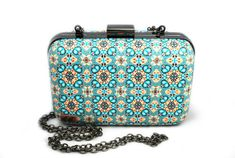 Purse covered in polymer clay kaleidoscope pattern cane by Anastasiya Arinovich.