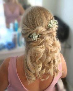 Curls come in all different sizes, big and  bouncy, boho, natural, using either GHDS,wand or tongs. So many choices! You wouldn't need to make any of those choices mind your stylist will do all that. This is a lovely natural looking half up half down with twists. Looks so pretty with the flowers in. What curl do you prefer?