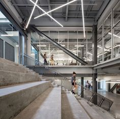 Inside, the architects created an industrial-style atmosphere, with concrete flooring, exposed structural elements and long communal tables.