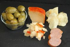 Enjoy this Perfect Pastorale Blend Pairing Plate this weekend with friends!  Garlic Stuffed Olives, Pastorale Blend cheese, Salt and Vinegar chips and some Polish Sausage.