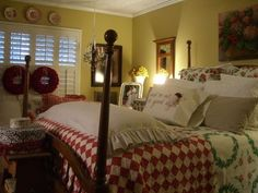 Country cozy bedroom with red and white checked comforter and 4 poster bed.  Yellow wall and detail pillows. #home #decor #cottage