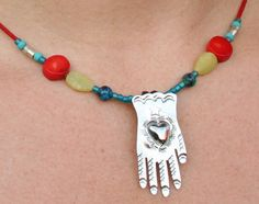 Hand from Mexico with coral, vintage green African trade beads