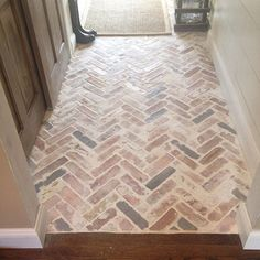 Not brick, but maybe herringbone slate with messy grout...