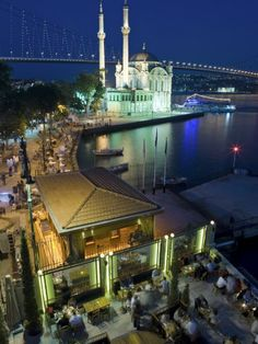ORTAKÖY at night. the streets are lined with restaurants, night clubs  bars, and shops. ortaköy, istanbul turkey.