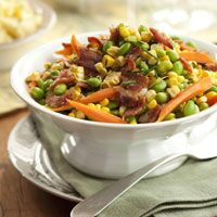 New World Succotash To keep current, we're using edamame — young, green soybeans that taste like a sweeter, livelier version of limas. But we're celebrating succotash's heritage, too, with fresh carrots and corn.