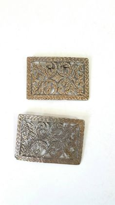 Check out this item in my Etsy shop https://www.etsy.com/listing/230360493/vintage-pewter-filagree-shoe-clips
