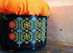 Tambor de lavadora pintado y bordado