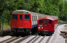 Underground trains for the London Underground come in two sizes - larger subsurface trains and smaller tube trains. A Metropolitan line A Stock train (left) passes a 1938 Stock train running a special service (right) near Croxley.