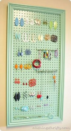DIY jewelry holder. I have the materials to make this. I already painted the peg board a similiar color. I was going to use it for necklaces but earrings would be good too! by Erin McComis