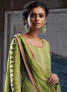 Light Green Embroidered Georgette Palazzo Suit features a beautiful georgette top alongside a satin bottom and chiffon dupatta. Embroidery work is completed with schiffli and thread embellishments. Kurta Designs Women, Kurti Neck Designs, Dress Neck Designs, Salwar Designs, Kurti Designs Party Wear, Blouse Designs, Full Sleeves Design, Sleeves Designs For Dresses, Neck Designs For Suits