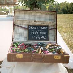 For an outdoor summer wedding, sunglasses make a perfect wedding favour!