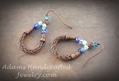 Eye-popping Varying Shades of Blue Czech Glass Beads Wire-wrapped Viking Weave Earrings in Copper Patina Finish. Original design by Daryl Adams.  Measurement: 1 3/8 inches x 3/4 inch.