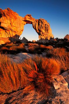 Landscape photograph of the wolfberg arch in sunset light in the cederberg mountain range in south africa