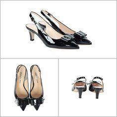 Kitten shoes (scarpe con tacco basso) aperte dietro (modello chanel) in pelle vernice nera con fiotto in punta. Bon ton.
