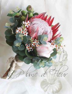 Alkina - Bride, bridesmaid bouquet. King protea, pink ice protea, Geraldton wax, gumnuts and Australian native foliage.